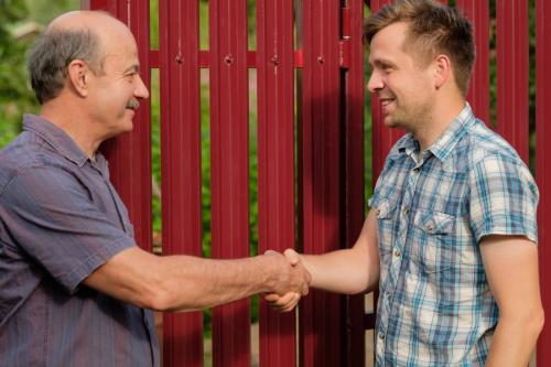 two men happy and shaking hands after agreement