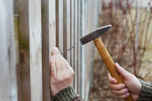 a fence being repaired