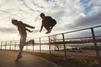 Two teenagers performing parkour